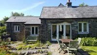 French window of Cwt Mochyn holiday cottage leading out to a patio